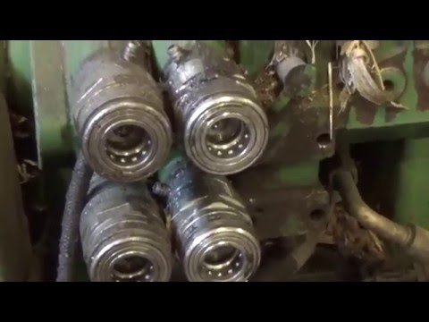 Changing hydraulic couplers on John Deere 6400