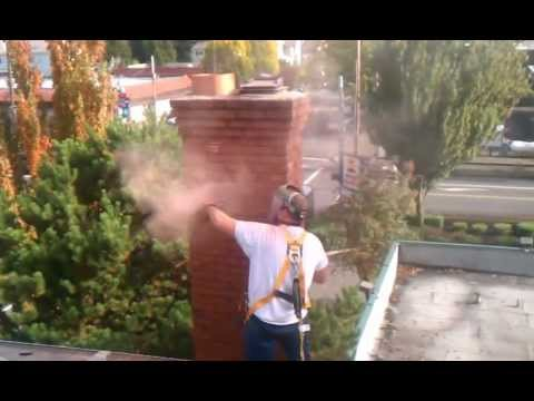 Grinding out chimney mortar joints.