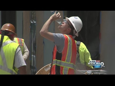 Outdoor workers try to stay cool in extreme heat
