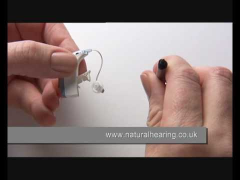 Changing a hearing aid battery www.naturalhearing.co.uk