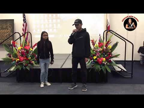 CAMBODIAN EXPERIENCE EXHIBIT-Dylan and Angelina performed open mic.