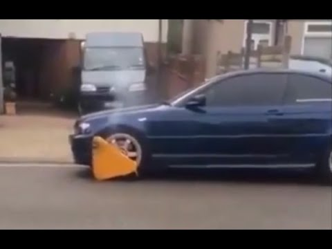 BMW with parking boot refuses to stop for anyone