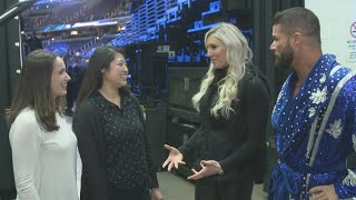 """Charlotte Flair and a pair of representatives for Girls Up show Bobby Roode how to """"Woo!"""""""