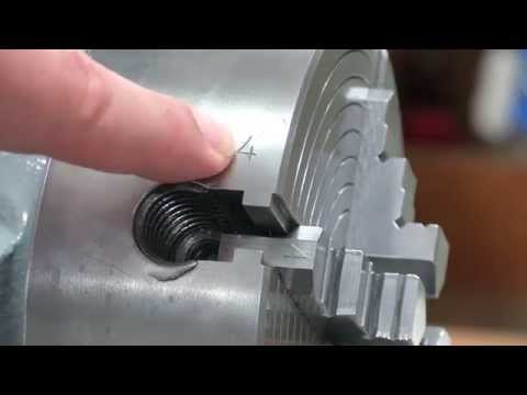 Truing the lathe chuck with a dremel on a South Bend lathe