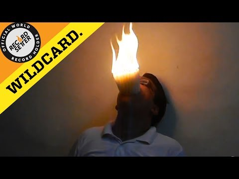 Most Burning Candles Fit In Mouth!