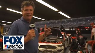 Michael Waltrip tours the garage after
