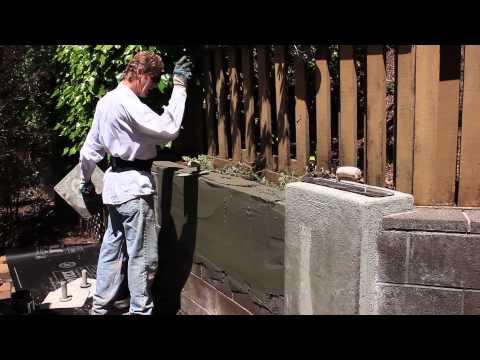 Steel trowel plaster finish over cinder blocks