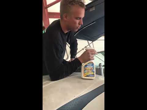 Demonstrating MiracleMist Instant Mold Stain Remover On Vinyl Boat Seats