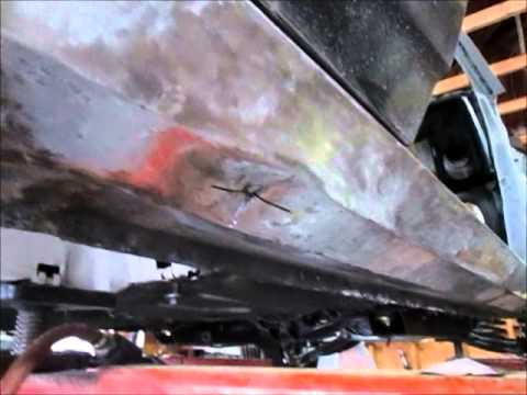 Deep dent repair in a rocker panel.