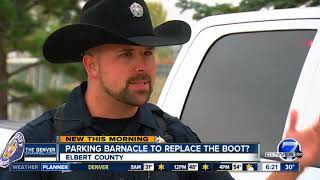 Out with the boot and in with the barnacle? New parking enforcement device being tested in Colorado