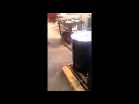 Naked Turner Cutting 30 Gallon Steel Barrels In Half