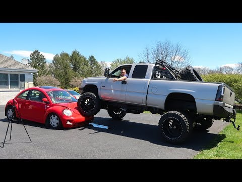 WE RAN OVER MY VW BEETLE WITH A LIFTED TRUCK!!!