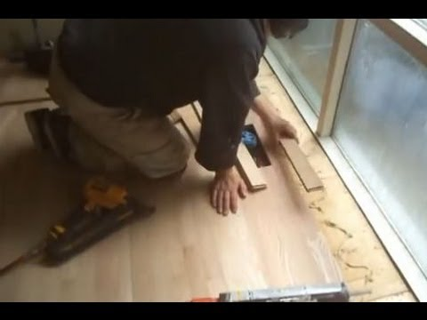 Installing Red Oak Unfinished Hardwood Flooring Close to the Windows and Patio Door
