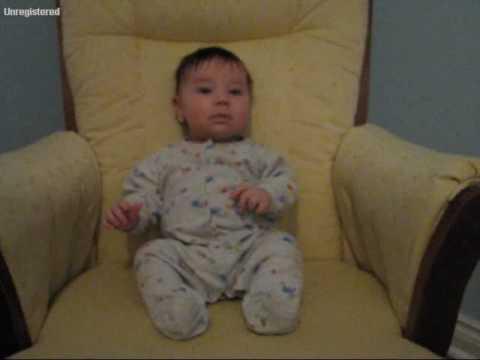 Hayden rocking in his nursery chair at 2 1/2 months