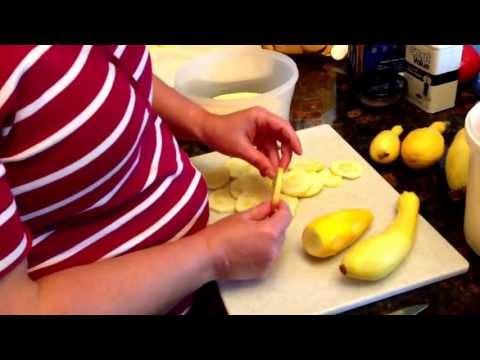 Breading yellow squash before freezing.
