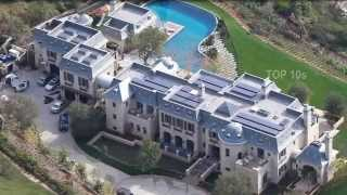 Top10 CRAZY CELEBRITY HOMES 10. Jay-Z and Beyonce Los Angeles, California If you're able to spend a lofty $150,000 a month on rent, you can actually live in Jay-Z and Beyonce's L.A. pad temporarily. The couple put up the house for rent in February 2015, and it's pretty sweet. Based in Holmby Hills, the 16,00 square-foot residence is an L-shaped series of glass-walled pavilions spread out over three floors. And with seven bedrooms (one of them a 2,000 square-foot master suite), an elevator, 75 foot-long gallery, fitness suite with massage room and a climate-controlled walk in wine cellar, that $150,000 at least goes a long way.  9. Liv Tyler Los Feliz, California Well, she used to live in it. The former Los Feliz mansion of Liv Tyler is still incredible to look at, though. She listed her luxury pad for $3.85 million back in 2014. It's hard to believe she would get rid of it considering it has grounds that are about nearly a third of an acre with mature palms, tropical flora, lush gardens and a pool. But I guess when you're a celebrity, you can get any badass house you want.  8. Ashton Kutcher Los Angeles, California Designed by Jeffrey and Rochelle Mills, Kutcher almost lost the home to Justin Bieber when he rented out the estate for $50,000 a month in late 2011. He saved it from the clutches of the Biebs though and bought the place for $8.45 million. The place is equipped with a glass bridge, open water features, five bedrooms and eight bathrooms.  7. Tom Brady, Gisele Bundchen and Dr. Dre Brentwood, California Previously owned by Tom Brady and Victoria's Secret Angel Gisele Bundchen, the hip-hop mogul dropped $40 million on the mansion. The French château-inspired estate is a whopping 18,298 square-feet (I know) has five bedrooms, nine bathrooms, seven fire places, waterfalls and lavish gardens. Anywhere that is good enough for these three would be definitely good enough for me.  6. Michael Bay Bel Air, California Of course the action flick mega director is going t