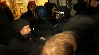 Protesters scuffle with police at AfD demonstration