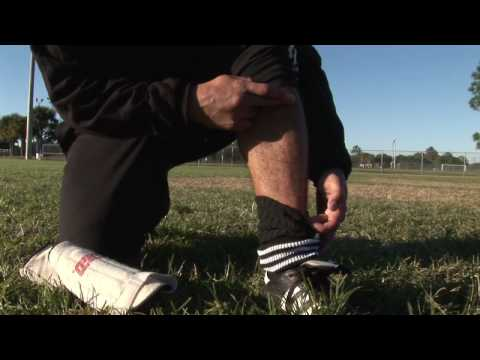 Soccer Tips & Moves : How to Put on Soccer Shin Guards