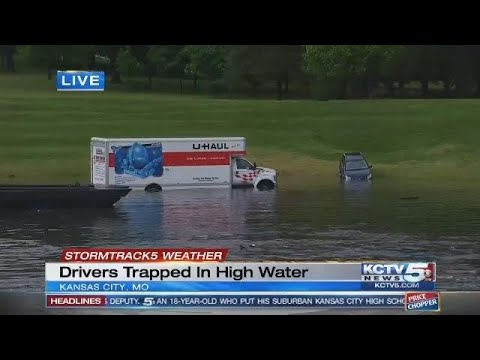 Moving truck, car submerged in Brush Creek as heavy rains cause flooding