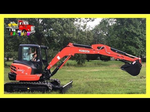 Kid Operating The  Kubota Mini Excavator KX057-4 And The Rollback