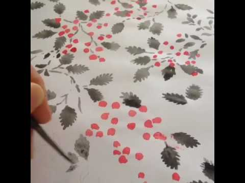 painting a fashion print design of leaves and berries