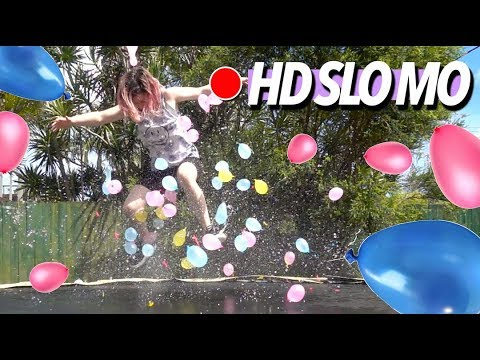 AWESOME TRAMPOLINE WATERBALLOON BOUNCE SLO MO!