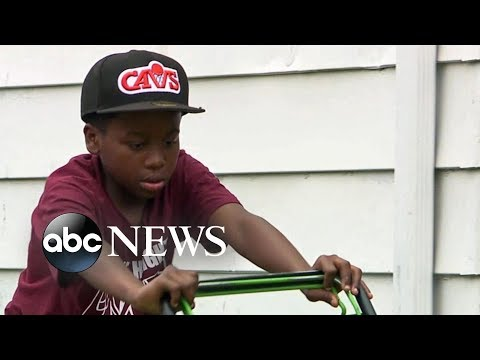 Neighborly dispute pays off for young lawn-mowing entrepreneur