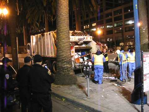 SF DPW disposing of #OccupySF protestor's belongings with a compacting garbage truck Dec 7th, 2011