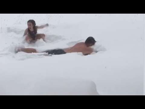 Father and Daughter Leave Hot Tub to Make Snow Angels in Bathing Suits