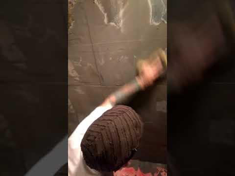 Grouting slate tile on a wall