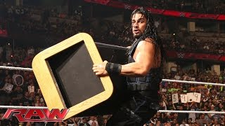 Roman Reigns crashes Seth Rollins and Kane