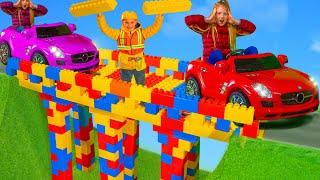 Kids Build a Bridge with Excavators, Fire Trucks, Police Cars & Toy Vehicles