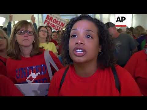 West Virginia teachers applaud pay raise ending 9-day strike