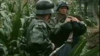 Two German soldiers on motorcycles try to abuse a girl