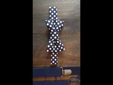 Close up of our boys navy bow tie and suspenders