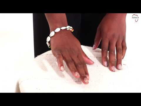 Cowrie shell bracelet: rasta bead from Africa Imports