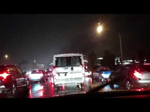 Bay Area traffic gridlocked in the rain on 101