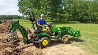 John Deere 1025r with 260 backhoe and Bxpanded Barracuda