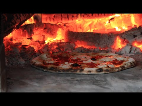How to Make a Wood-Fired, Brick-Oven Pizza in 4 minutes, 28 seconds.