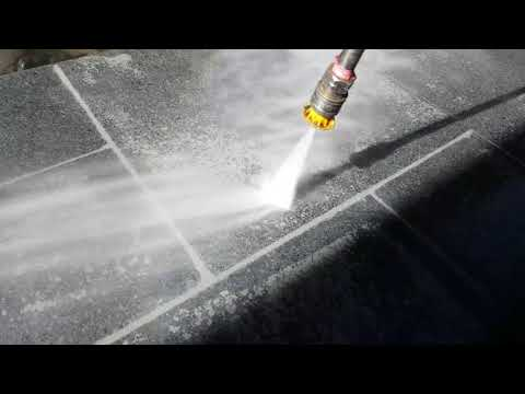 High pressure cleaning off grout residue on pavers