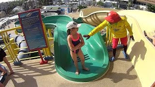 Small Lady on the Green Tube Water Slide at Splash Jungle Water Park