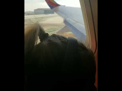 Two year old toddler reaction to flying on a plane for the first time.  Super cute!