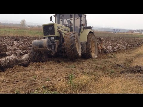 Plowing with tractor Hurlimann H-496T