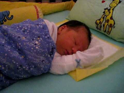 Ethan new baby sleeping in cot at home