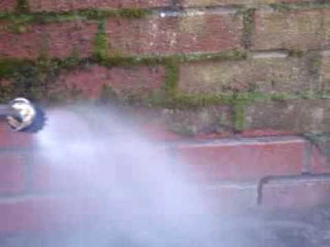 Expert Jet Washing moss off a wall by Nutech Cleaning