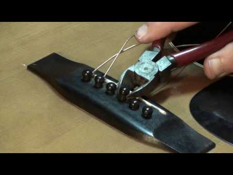 Tips for removing bridge pins on acousric guitar by Randy Schartiger Quick Clip Tips