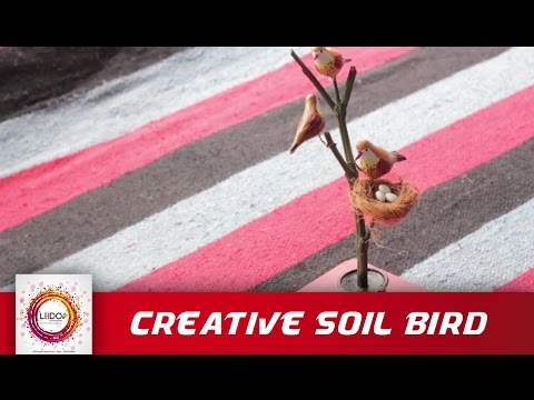 Making creative bird artwork with soil