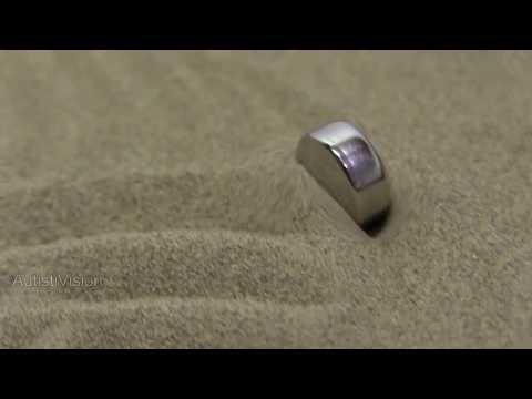 Button cell battery in a SandScript