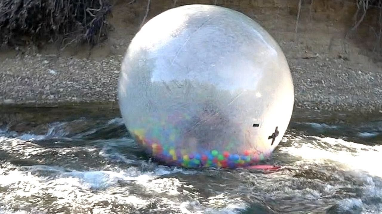 Floating Down The Creek In A Giant Hamster Ball