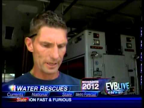 Scott Light, EVB Live, and Mike Thomas, MFMD, discussing water rescues